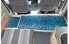 Der geänderte Tisch erlaubt optional den Umbau zum Bett beim La Strada Avanti L